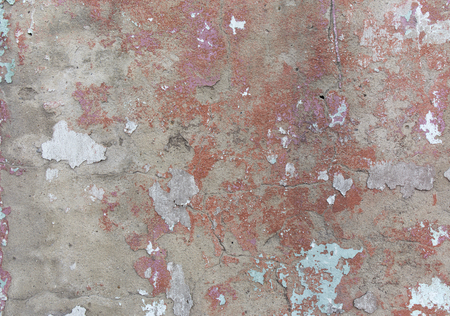 beton: Old painted wall. Green and pink damage surface. Peeling paint background. Stone demaged backdrop