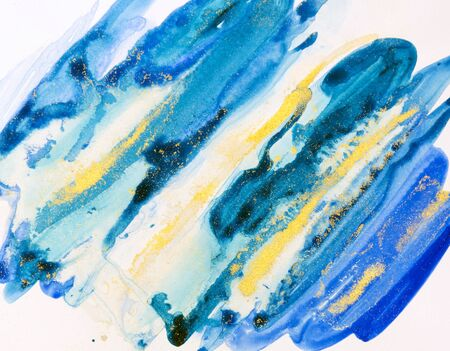 Watercolor background painting on white paper. Blue, green and golden abstract texture. Color smudges surface.
