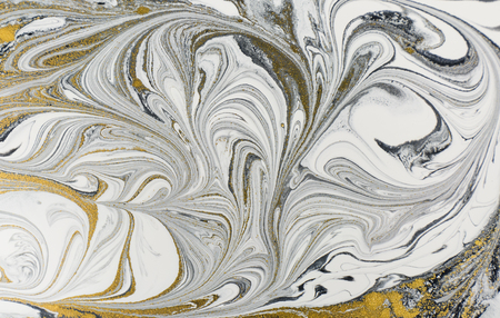Marble abstract acrylic background. Nature black marbling artwork texture. Golden glitter.
