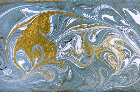 Marble abstract acrylic background. Nature blue marbling artwork texture. Gold glitter.
