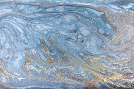 Marmor abstrakt Acryl Hintergrund. Blaue marmornde Grafikbeschaffenheit der Natur. Goldglitter.