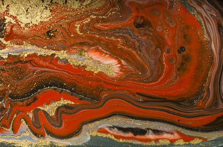 Gold marbling texture design. Red and golden marble pattern. Fluid art. Stock Photo