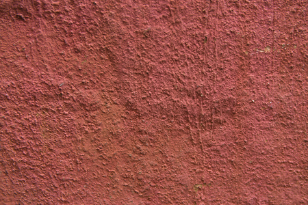 Rough red decorative facade plasters texture.