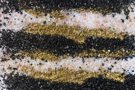 Layered colorful sand pattern. Marble style background. Black, white and gold powder texture