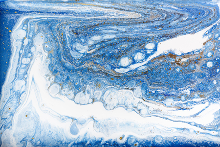 Blue and white marbling pattern with gold glitter. Marble liquid texture