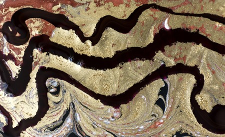 Gold, bronze and black marbling pattern. Golden marble liquid texture.