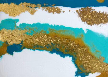 Patrón de veteado azul y dorado. Textura líquida de mármol dorado.