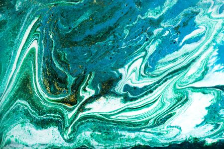 Liquid uneven blue and green marbling pattern with glare of light