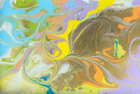 Colorful pastel marble pattern with golden glitter. Abstract liquid background