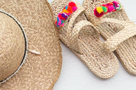Bohemian straw wicker hat and slippers. Boho stile mosk up Reklamní fotografie