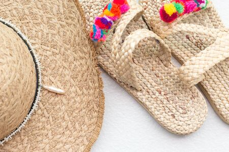 Bohemian straw wicker hat and slippers. Boho stile mosk up. Reklamní fotografie