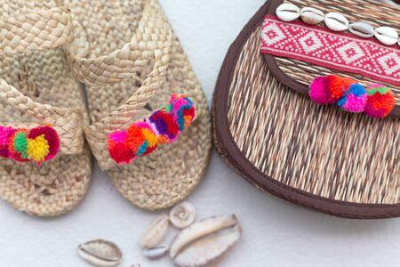 Bohemian straw wicker bag and slippers. Boho stile mosk up. Reklamní fotografie