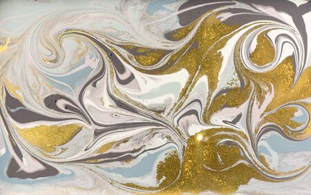 Pale marble pattern with golden glitter. Abstract liquid background.