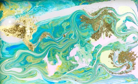 Pale blue marble pattern with golden glitter. Abstract liquid background.
