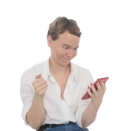 Girl looks at the phone and gets angry. Annoying call. Emotional woman.