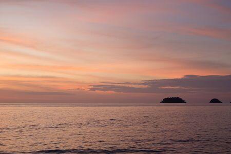 Sea pink sunset. Beautiful color clouds.