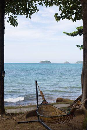Wicker hammock on a tropical beach sea background. Reklamní fotografie