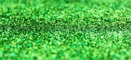 Blur green sparkle background. Defocused glitter texture. Reklamní fotografie