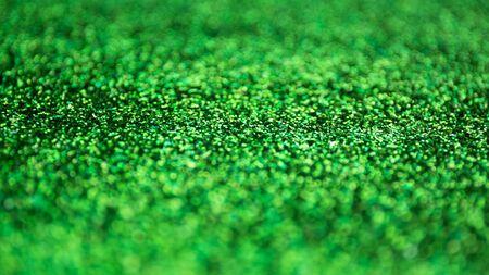 Blur green sparkle background. Defocused glitter texture Reklamní fotografie