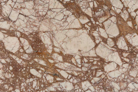 Marble brown stone texture. Light wall background.