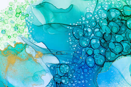 Aquamarine alcohol ink gradient texture. Abstract watercolour background with gold powder.