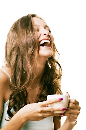tea mug: Beautiful laughing girl with a morning cup of tea in his hands Stock Photo