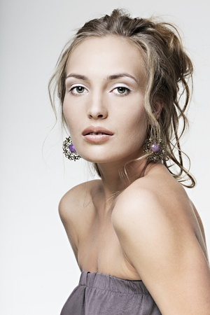 beautiful face girl with perfect skin wearing jewelry