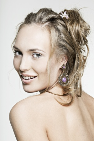 beautiful face smiling girl with perfect skin wearing jewelry