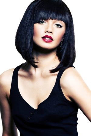 beautiful girl with perfect skin, red lipstick and black hair on white background photo
