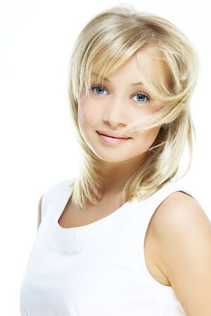 beautiful girl with perfect skin, blond hair and blue eyes on a light background in white dress Stock Photo - 11313123