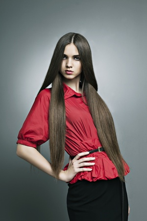 beautiful girl with perfect skin and long straight hair photo