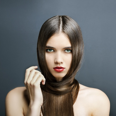 beautiful girl with perfect skin, red lipstick and long, smooth hair Stock Photo