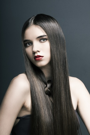 beautiful girl with perfect skin, red lipstick and long, smooth hair Stock Photo - 11313154
