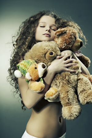 Beautiful girl smiling holding a gift - toys