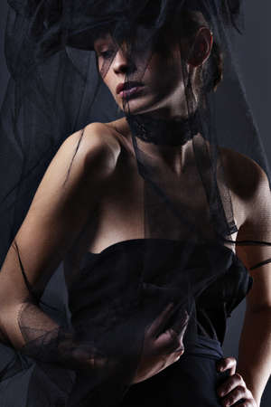 beautiful elegant woman in a long dress and veil photo