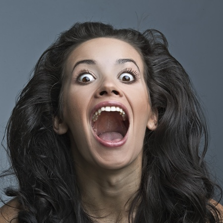 pharynx: Beautiful insane woman screaming and wonders Stock Photo