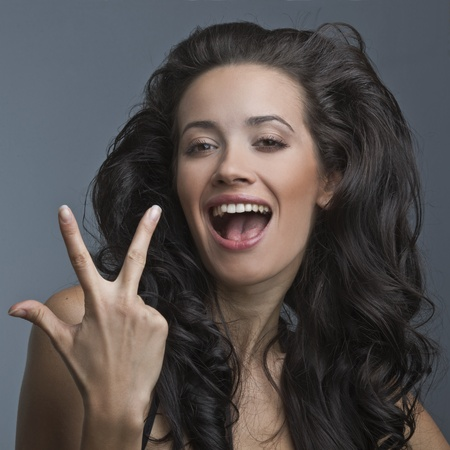 crazy woman: A beautiful woman is showing signs of positive emotions Stock Photo