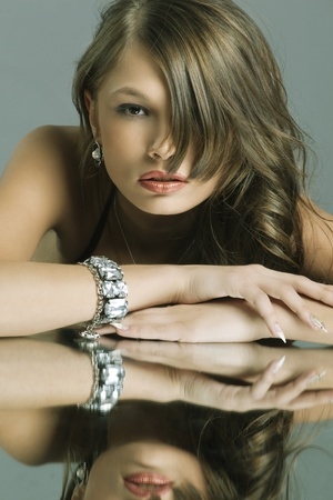 Portrait of a beautiful woman with jewelry and evening make-up photo