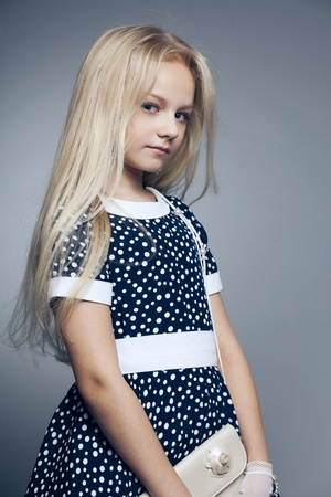 beautiful little girl with long hair svetlyi on a dark background