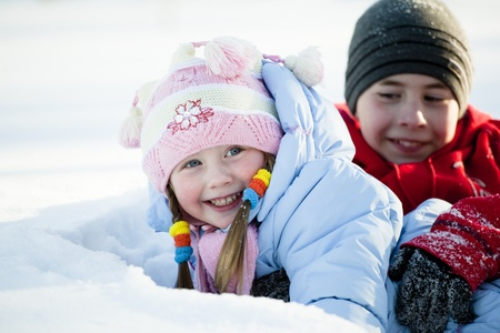 Portrait of children playing in the snow in the winter photo