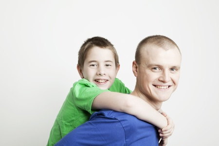 Portrait of beautiful smiling family: father and son on a white background