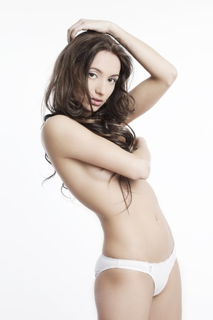 beautiful body of a young woman with perfect skin and a figure  on a white background Stock Photo