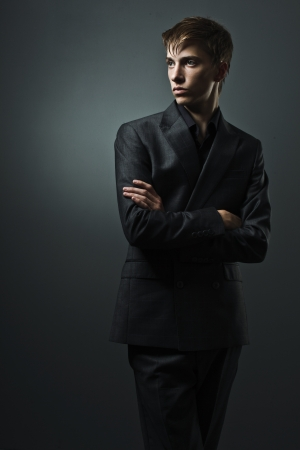 handsome man in a business suit on a dark background Stock Photo - 15865815