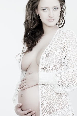 beautiful pregnant woman on a white background