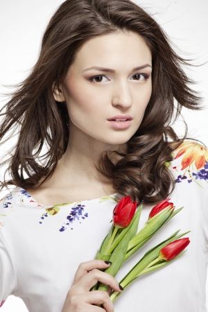 beautiful smiling woman with flowers Stock Photo - 18571814