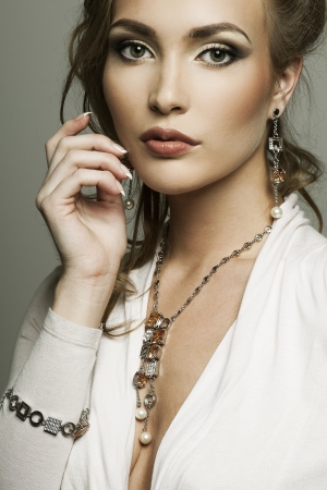 portrait of a beautyful woman with perfect makeup wearing jewelry  photo