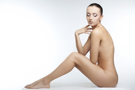 sexy naked woman: beautiful nude woman with perfect skin on a white background