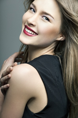 pretty girl: beautiful smiling girl with perfect skin on a dark background Stock Photo
