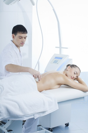 vacuum massage procedure in the medical beauty center Stock Photo