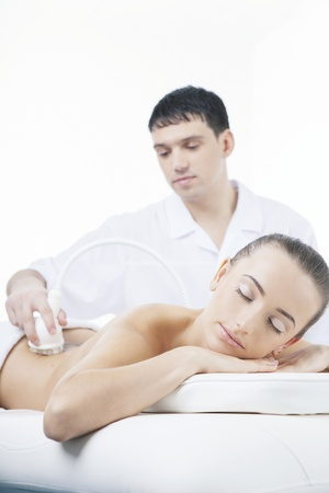 vacuum massage procedure in the medical beauty center  photo